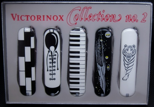 A Victorinox B&W Art Deco styled series of knives featuring 5 different designs on Cellidor scaled 74mm Ambassador w/keyring models.
