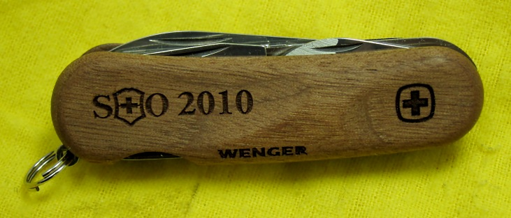 The SOSAK 2010 KOTY is a Wenger Evo-Wood 18 with the SOSAK logo and year imprinted on the top scale.  The Evo-Wood Series was first introduced in 2010.
