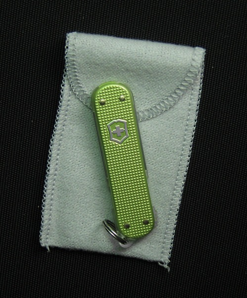 A Victorinox 2011 SlimFlash with light green anodized Alox handles and supplied pouch.