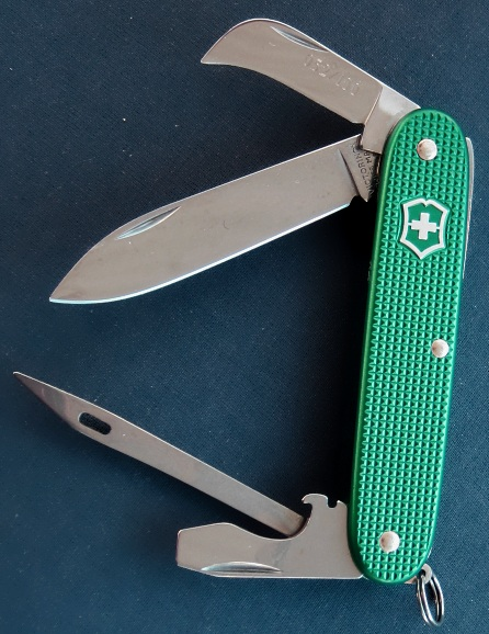 This Victorinox Aqua-Green anodized Alox Pioneer Ranger with Marlinspike/Sacking-Needle instead of the typically Reamer tool was manufactured in 2011 as part of a special limited run of 100 knives. The knives are individually numbered on the small pruner/hawkbill blade. The Aqua-Green color anodizing is very rare, and not known to have existed on a 93mm Alox model prior to this. This model/configuration needs a good name.