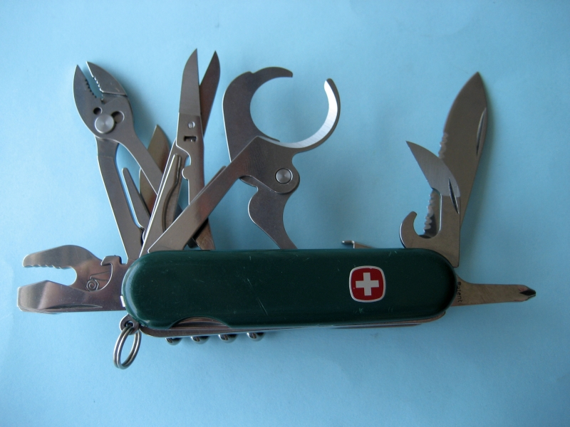 A Wenger Master Tool 13 with Orvis brand and green traditional scales. This model was sold as the