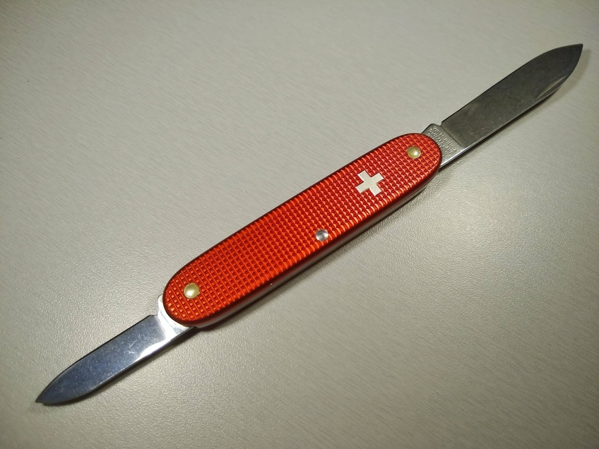 Red alox with silver Swiss cross variant